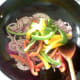 Stir frying red onion and bell peppers