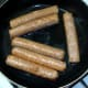 Vegan sausages are gently shallow fried in oil