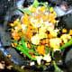 Add chopped tomato, green chillies, and fennel seed powder. Stir.