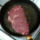 Sirloin steak is put on to fry