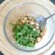 Chickpeas and coriander are added to raita sauce