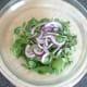 Combining chicken salad ingredients