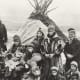 Sami people in Norway in front of two Lavvo Tents around AD 1920.
