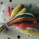 Plastic coloured copper wire with attached alligator clips to allow for various circuit configurations.