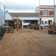 Ripping out planters and other fixtures inside the Poteau Pocket Park (Town Square)
