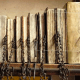 Books were secured to the shelf with a long metal bar going through each chain.