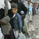 Scores of people standing in queue to get relief material after the earthquake