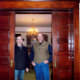 John and Rob stand between a pair of the many sliding wood doors stained and kept in immaculate operation and appearance.