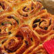 Brush the warm cinnamon rolls with honey, apricot jam, or sugar syrup. Let them stand until set.