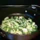 Frying the leeks.