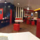 Very bright red interior with large booth tables good for groups of 4 and up!