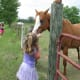 Audrie's careful not to get a horse bite.