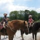 Two of the grands about to go trail riding. Notice the riding helmets?