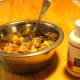Add an enzyme and probiotics powdered supplement formulated for dogs before serving. Stir thoroughly.