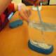 Mixing packet 1 in the aquarium.