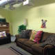 Living room space at shelter aids in helping dogs adapt to a home environment while waiting to be adopted