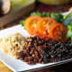 Cooked white, red, and black quinoa