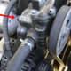 Power steering pump belt locking bolt.