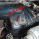Remove bolts from thermostat retainer.