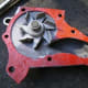 AA. Water pump gasket with sealant