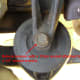 Remove the upper motor mount bolt.