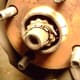 E.  Remove cotter pin (A) and axle shaft nut cover (B)