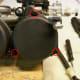 Remove the carburetor top screws (circled in red). Remove the vacuum piston and vacuum piston spring under the carburetor top.