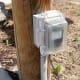 Surface mounted on a post bordering a driveway.  Not an RV outlet.