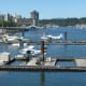 Float planes with Stanley Park in the background
