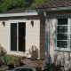 Careful exterior and roof choices made this cottage match the adjoining house.