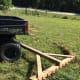 Raking hay with a UTV.