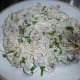 Spaghetti with cream cheese, greens and onion sauce.