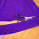 Cut a stretchy purple t-shirt to create a long strip of fabric to use as a belt.