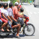 Riding a motorcycle or habal-habal in the Philippines.