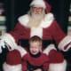 Who is unhappier -- Santa or this boy?