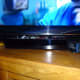 The optical audio switch sitting on the TV's 'One Connect' box
