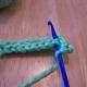 Hook goes through both loops of V.