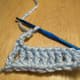 End of row 1 for treble crochet, chain 4 before turning.