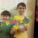 My boys proudly showing off their coffee filter fish!