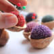 I don't know if these pincushions are filled with ground shells, but that would add the perfect touch to this idea.