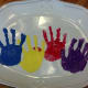 The ceramic platter with all four handprint flowers.