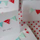 You can simply sew the bunting on without using any adhesive.