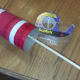 Attach a wooden stick to inside of toilet paper roll with tape (optional).