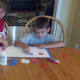 Use glue to attach paper strips to inside of letter outline.