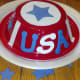 Use stars, stripes, and letters to decorate your patriotic hat.
