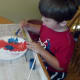 My son working hard on his coffee filter.