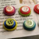 Some of my first ever button stacks ready to be made into magnets.