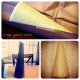 Using colorful tissue paper, wrap your cone and secure with tape.