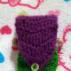 Hair on mermaid cozy is used as flap and fastened with a button.