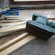 Sander with fine grade sanding paper to make the timber smooth.